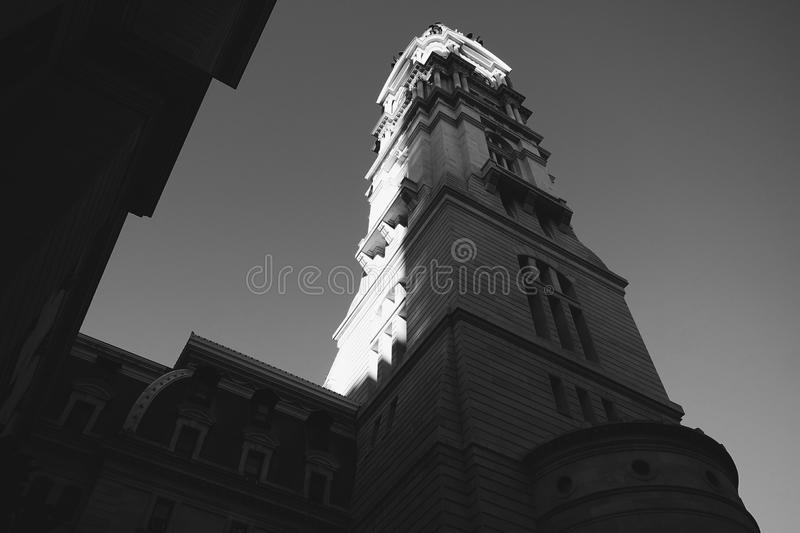 City Hall Philadelphia. City Hall in Philadelphia captured at a low angle as the sun partially graces it stock image