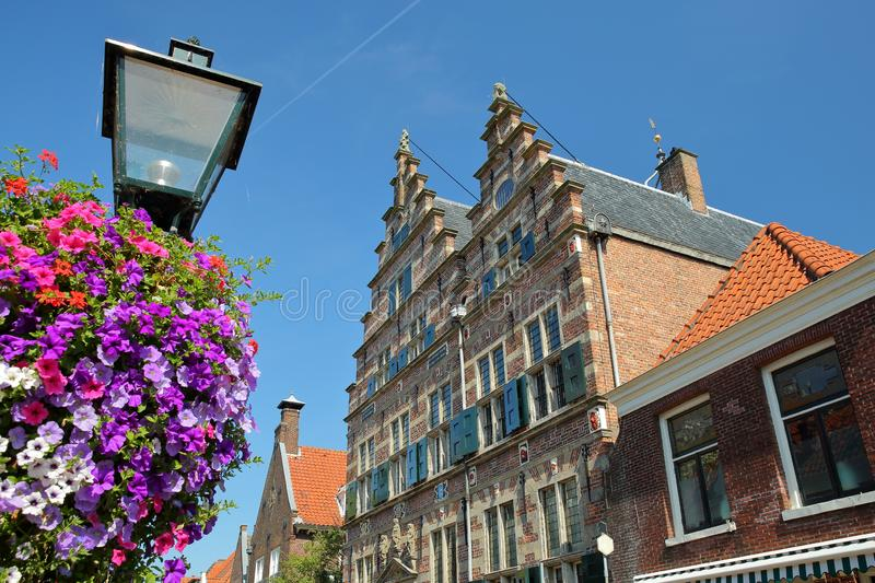 The City Hall Stadhuis, built in 1601 with colorful flowers in the foreground, Naarden, Netherlands. This hall nowadays is used as a wedding Hall royalty free stock image