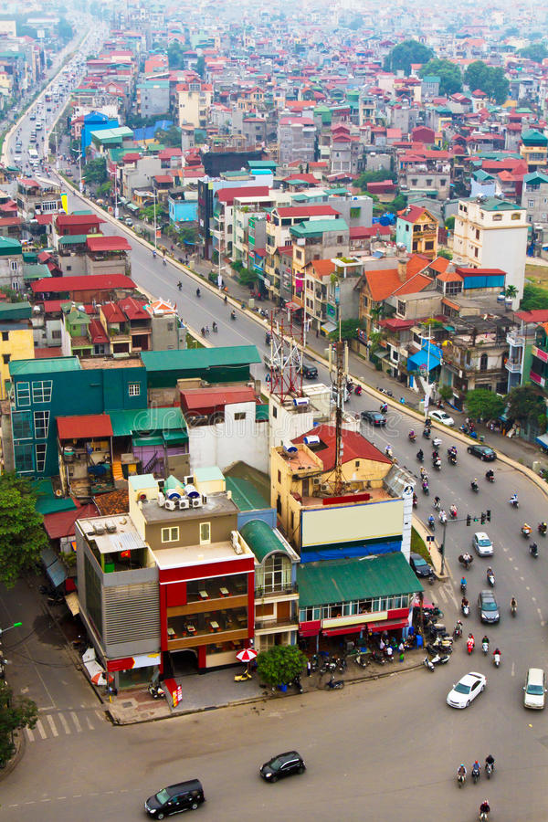 The city(Hanoi) of Vietnam. The capital city(Hanoi) of Vietnam. The main road and crowded houses in the suburb of Hanoi royalty free stock image