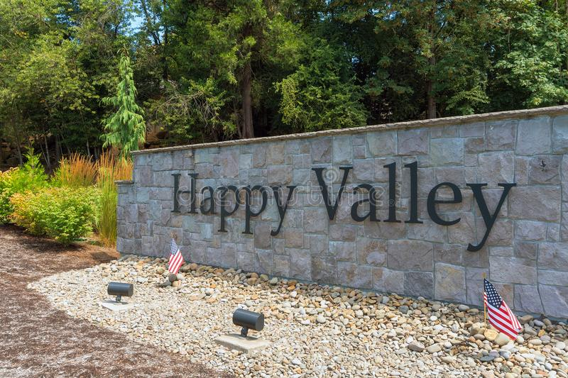 City of Happy Valley Stone Wall Sign Closeup. City of Happy Valley Oregon stone wall in the park with landscaping closeup stock photography