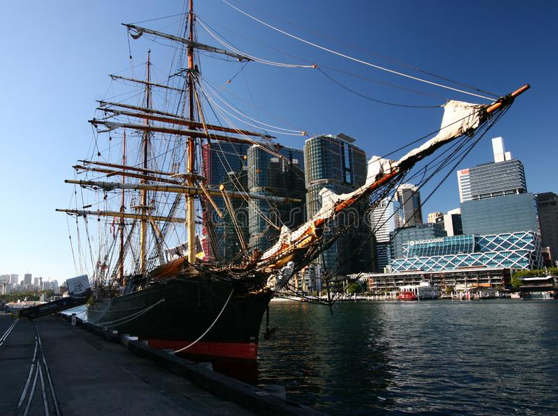 Moored historic sailing ship with iconic cityscape of modern skyscrapers on harbor waterfront, Darling Harbour, Sydney, Australia royalty free stock images