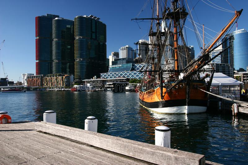 Moored historic sailing ship with iconic cityscape of modern skyscrapers on harbor waterfront, Darling Harbour, Sydney, Australia royalty free stock photos