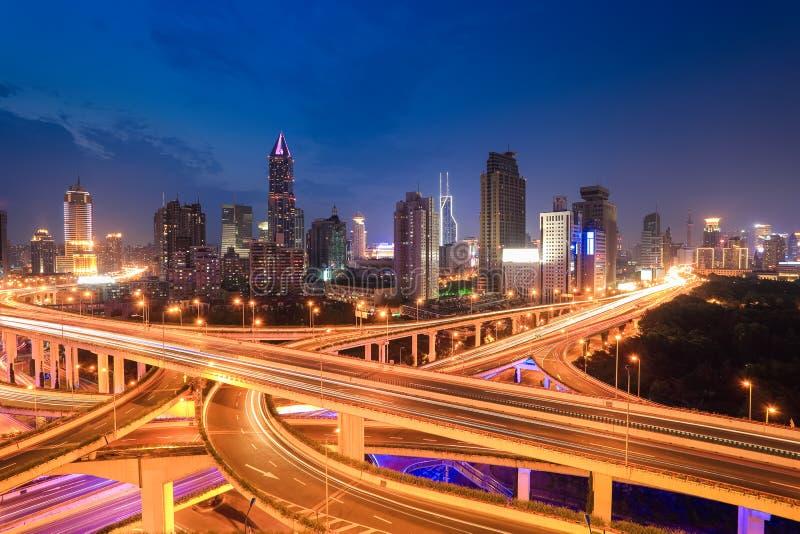 City highway traffic in nightfall royalty free stock image