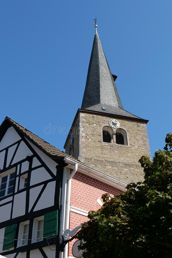 Hilden, Germany, Europe - tops of the church spire of the Reformationskirche and a timbered house. The city of Hilden belongs to the county of Mettmann in the stock photos