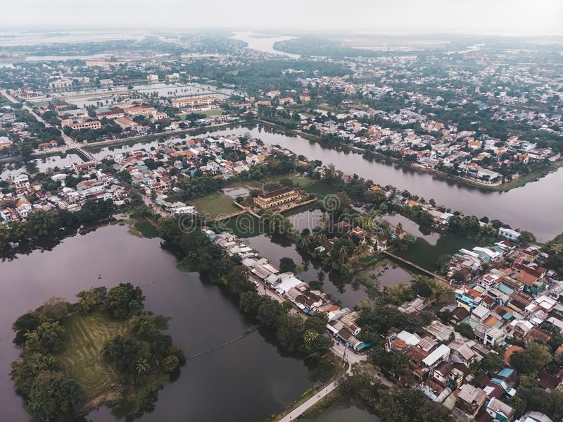 The city of hue in the mist of Vietnam. The view from the top. Aerial view. Rainy season, winter. Lake in the city centre of hue royalty free stock image