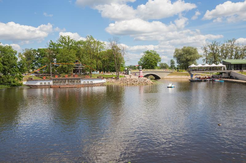 City Jelgava, Latvian Republic. River Lielupe, peoples and urban city view. Houses and walking paths. Jun 9. 2019. Travel photo stock photography