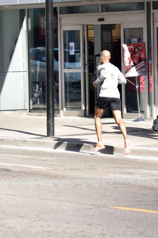 City jogger royalty free stock photography