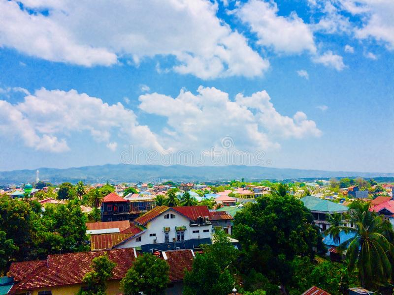 City of Kendari. The appearance of The Kendari City from above the parking area of a mall during the day stock photos