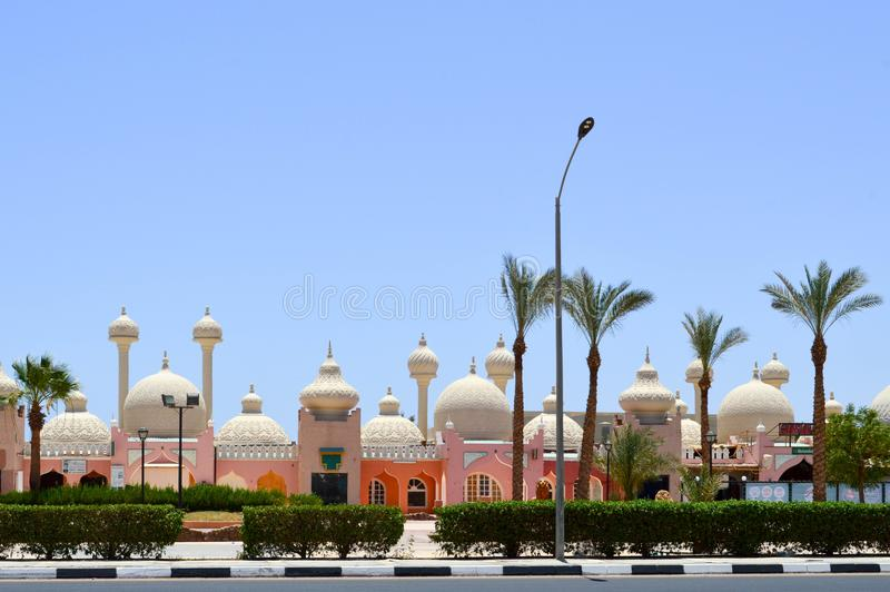 landscape with beautiful temples, mosques, buildings with round domes in the Arab Muslim Muslim Egyptian street against the backd royalty free stock photography