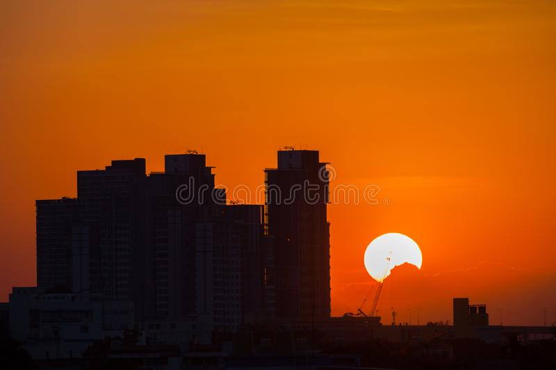 City landscape of sunset above buildings. Of under colorful sky at sunset time located at center of Bangkok Thailand stock photo