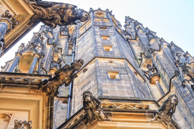 City landscape - view of the gargoyles of the Metropolitan Cathedral of Saint Vitus, located within the Prague Castle complex stock images