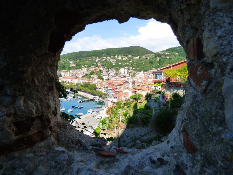 The city of Lerici viewed through the cannon port of the castle stock images