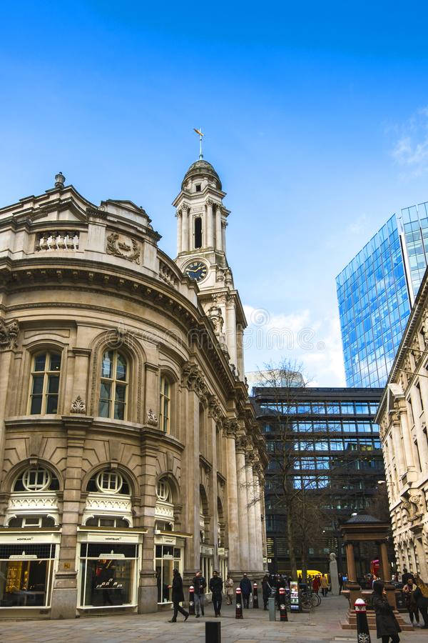 City life in the Royal Exchange area. Luxurious shops and a mixture of old and new buildings. LONDON. ENGLAND - March 20 2018: City life in the Royal Exchange stock photos