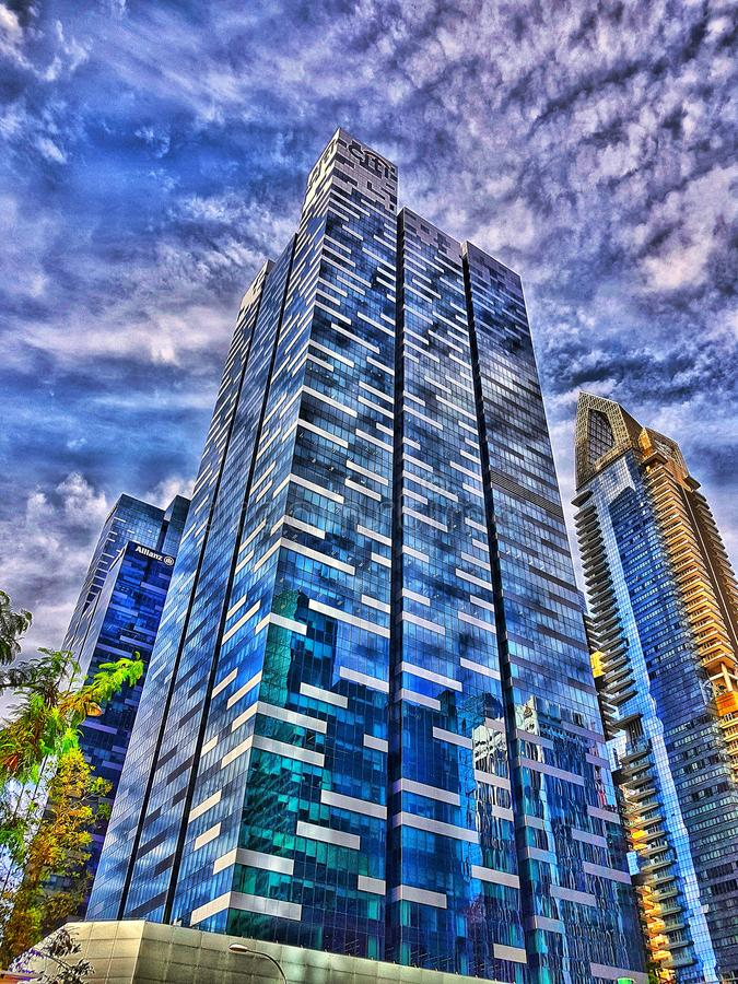 City lifestyle with blue sky and skyscraper building in singapore. Morning clear blue sky with tall modern architecture in Singapore. High definition clear royalty free stock image