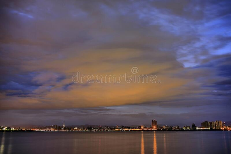City Light Reflecting on Calm Waters Night Time royalty free stock image