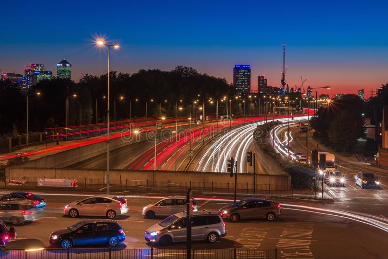 City light trails of fast moving car traffic on road in London at night stock photos