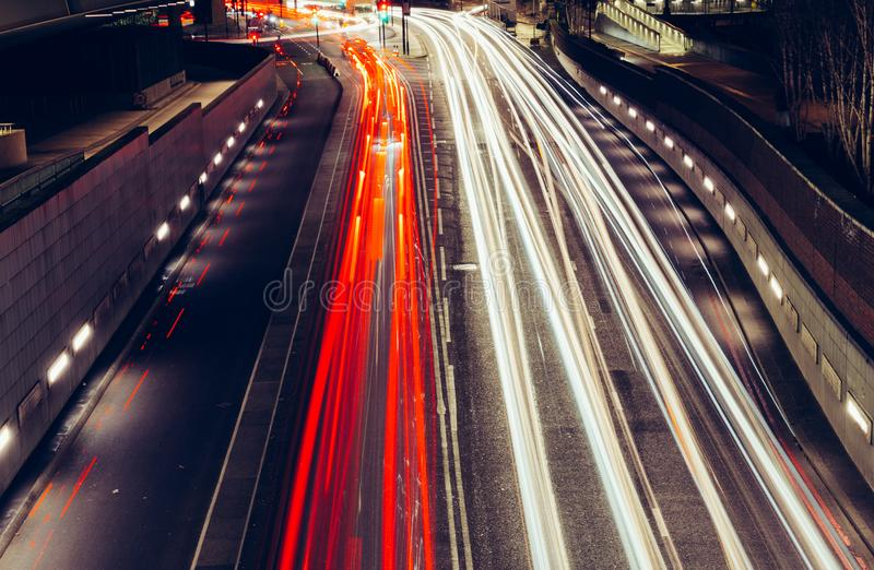 City light trails of fast moving traffic on road in London at ni stock image