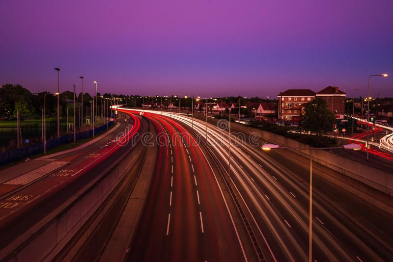 City light trails of fast moving traffic on road in London at ni royalty free stock image