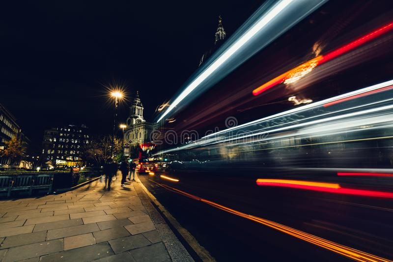 City light trails of moving red London bus at night royalty free stock photos