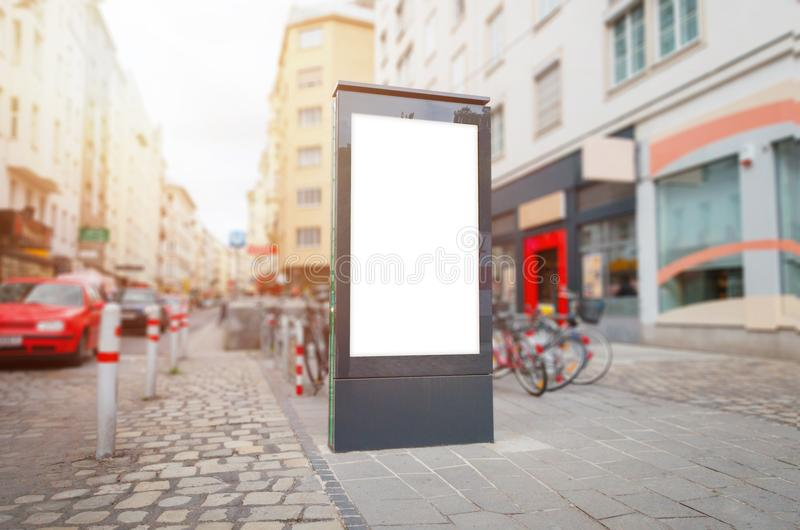 City light, video led billboard mockup on street. Cars in background.  royalty free stock images