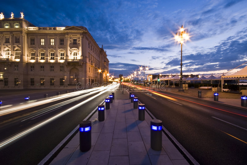 City Lights. Car city lights in front of Piazza Unità d'Italia at dusk / sunset - Trieste, Italy 2007 stock photography