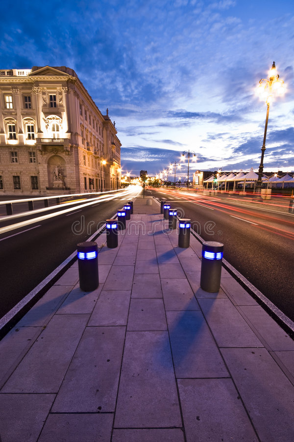City Lights. Car city lights in front of Piazza Unità d'Italia at dusk / sunset - Trieste, Italy 2007 royalty free stock photo