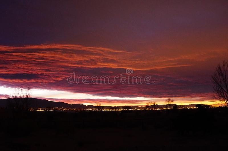 The city lights of Albuquerque NM with a bright sunrise royalty free stock photo