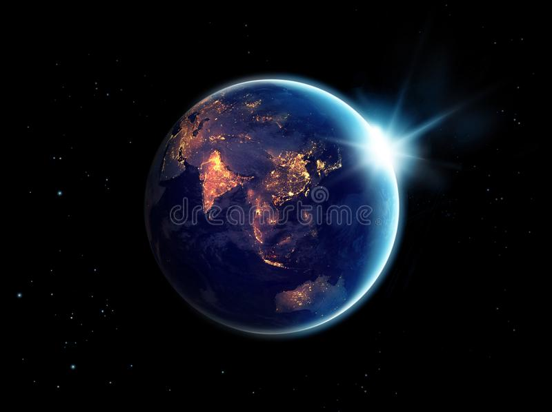 City lights at night in planet earth with with sun rising. Elements of this image furnished by NASA royalty free stock images