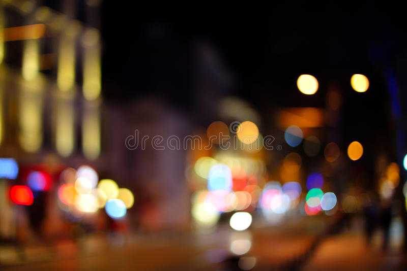 City lights night view, blur bokeh photo. Blurred background with lights of the city at night. Bokeh basic background for design stock photos