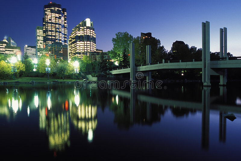 City lights reflect in river royalty free stock images