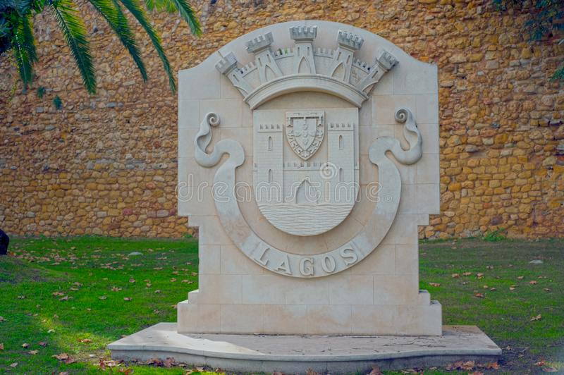 City limits sign in Lagos Portugal. Photograph of the traditional stone city limits sign of Lagos, Portugal royalty free stock photo