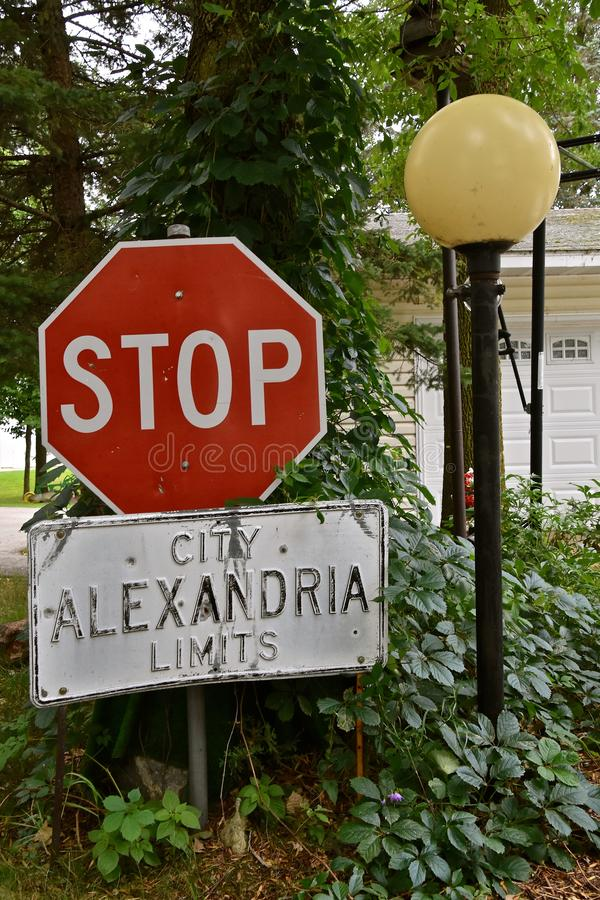 City limits and stop sign. Stop sign at the city limits of Alexandria which are placed together stock photo