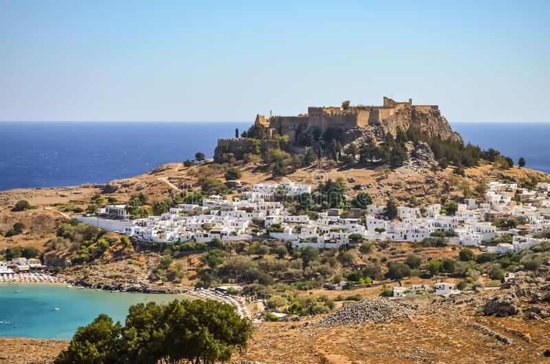 City Of Lindos In Rhodes Greece with the Castle and ruin on top of the Hill. City Of Lindos In Rhodes Greece with the Castle and ruin ontop of the Hill and white royalty free stock photography