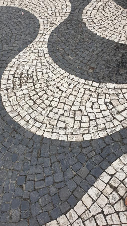 The beautiful pavement of the streets of the city of a lisbon stock photography