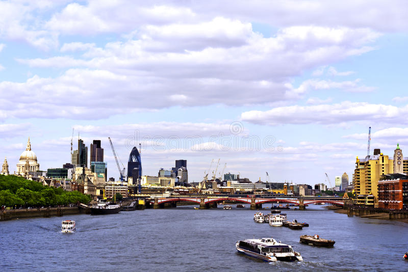 City of London. View from Waterloo Bridge. This view includes: St. Paul`s Cathedral, The Gherkin, Tower 42, Blackfriars Bridge and Canary Wharf royalty free stock image