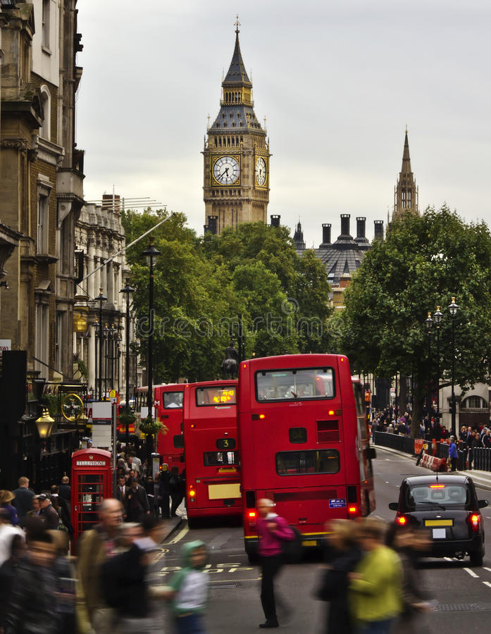 City of London. View from Trafalgar Square: Big Ben, double deckers, red phonebox, taxi cab, people royalty free stock image