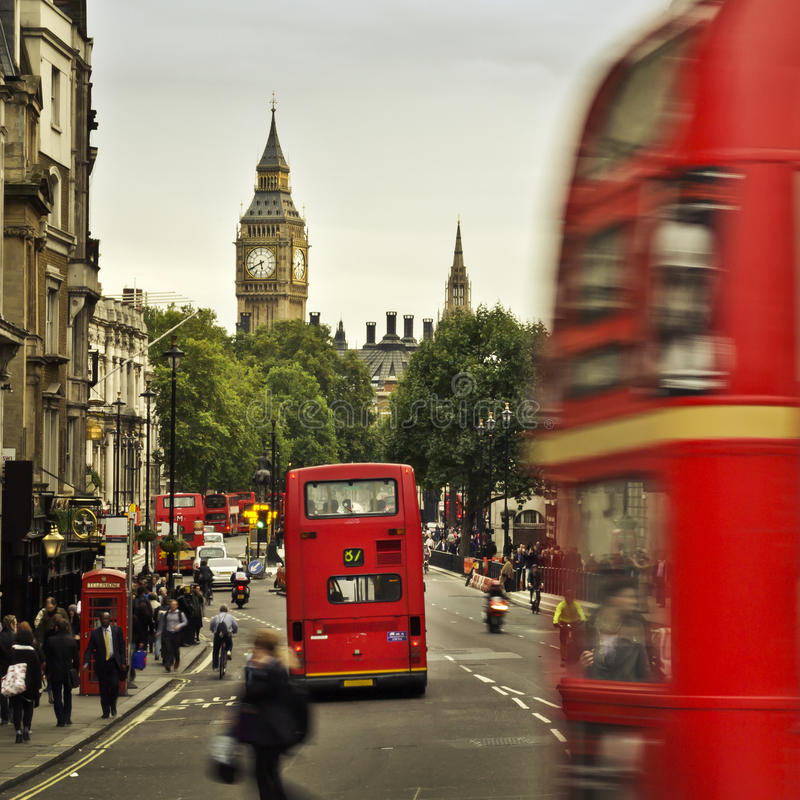 City of London. View from Trafalgar Square: Big Ben, double deckers, red phonebox, taxi cab, people royalty free stock photo