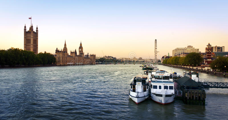 City of London. Houses of Parliament, Big Ben, Westminster Bridge and London Eye at dusk, London royalty free stock photos