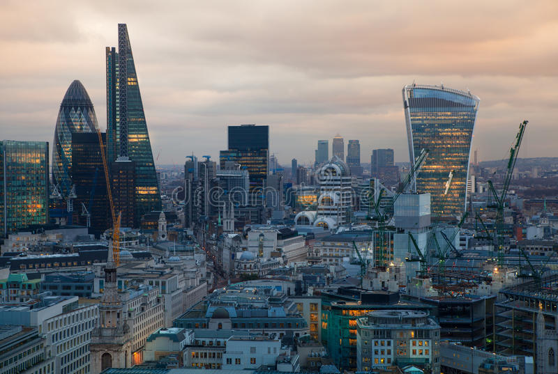 City of London, business and banking aria. London's panorama in sun set. View from the St. Paul cathedral. LONDON, UK - JANUARY 27, 2015: City of London stock photos