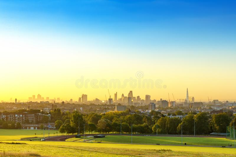 The City of London Cityscape at Sunrise with early Morning Mist from Hampstead Heath. Buildings include the Shard, Gherkin 30 St M stock images