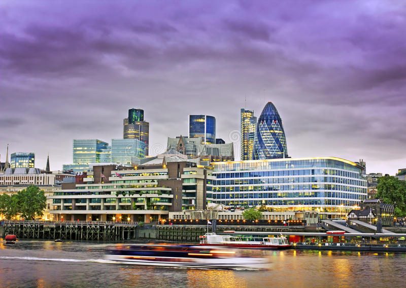 City of London financial district. London skyline seen from the River Thames at twilight stock images