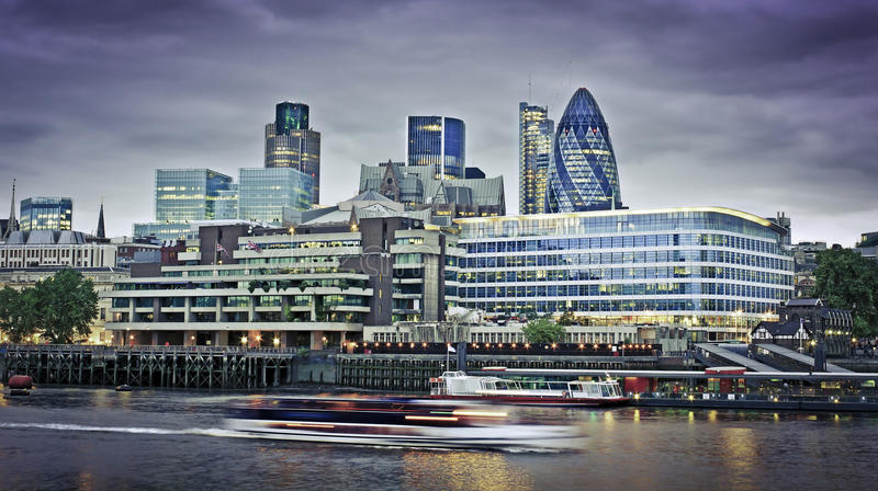 City of London financial district. London skyline seen from the River Thames at twilight royalty free stock images