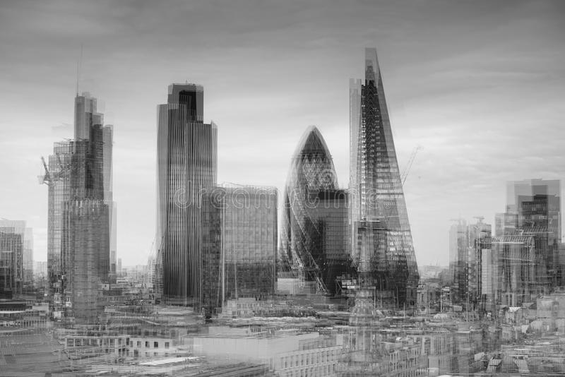 City of London financial district square mile skyline with storm with double exposrue effect stock image