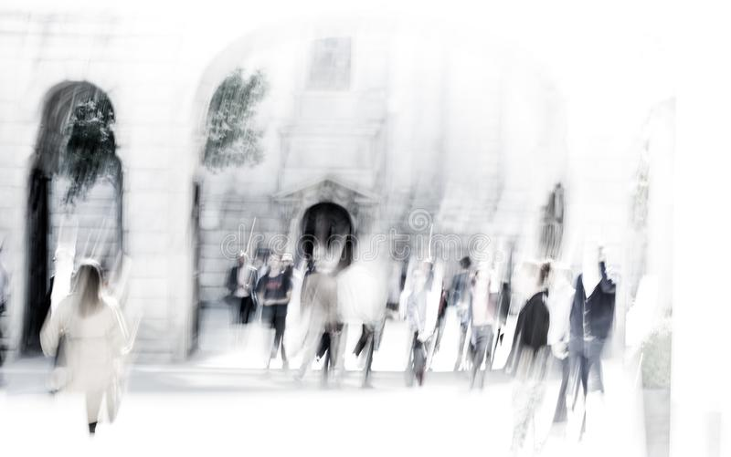 City of London lunch time. Blurred image of office people walking on the street. London, UK. LONDON UK - SEPTEMBER 10, 2015: City of London lunch time. Blurred stock photography