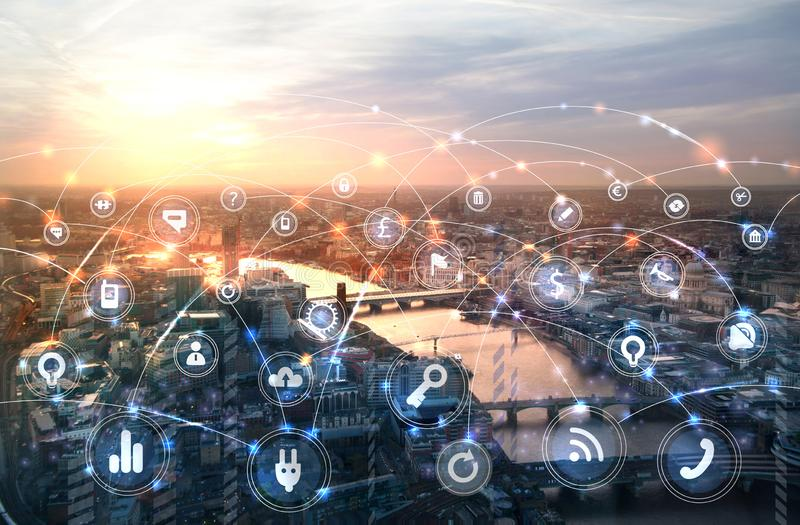 City of London and river Thames at sunset. Illustration with communication and business icons, network connections concept. Modern skyscrapers and financial stock photography