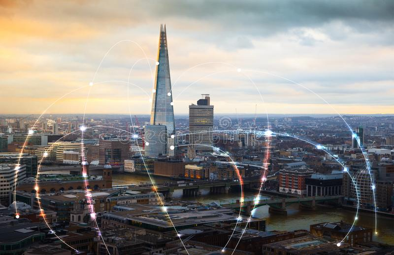 City of London and river Thames at sunset. Illustration with communication and business icons, network connections concept. Modern skyscrapers and financial royalty free stock image