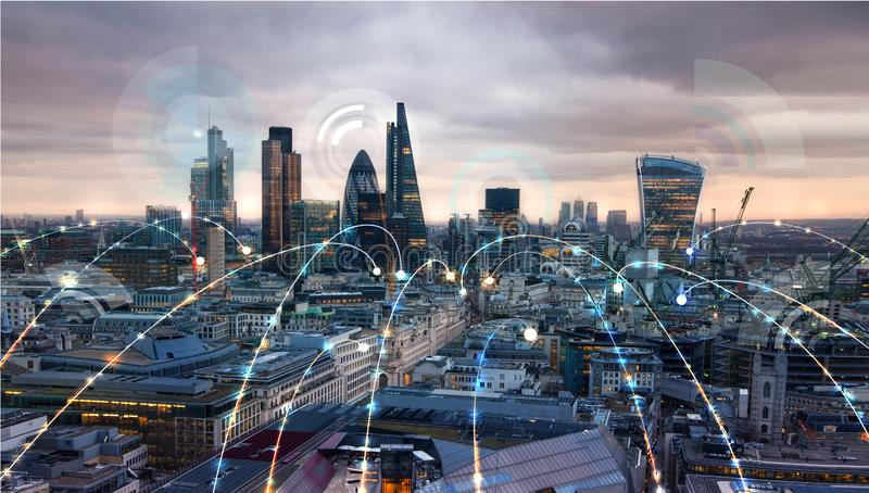 City of London at sunset. Illustration with communication and business icons, network connections concept. Modern skyscrapers and financial aria. London stock photography