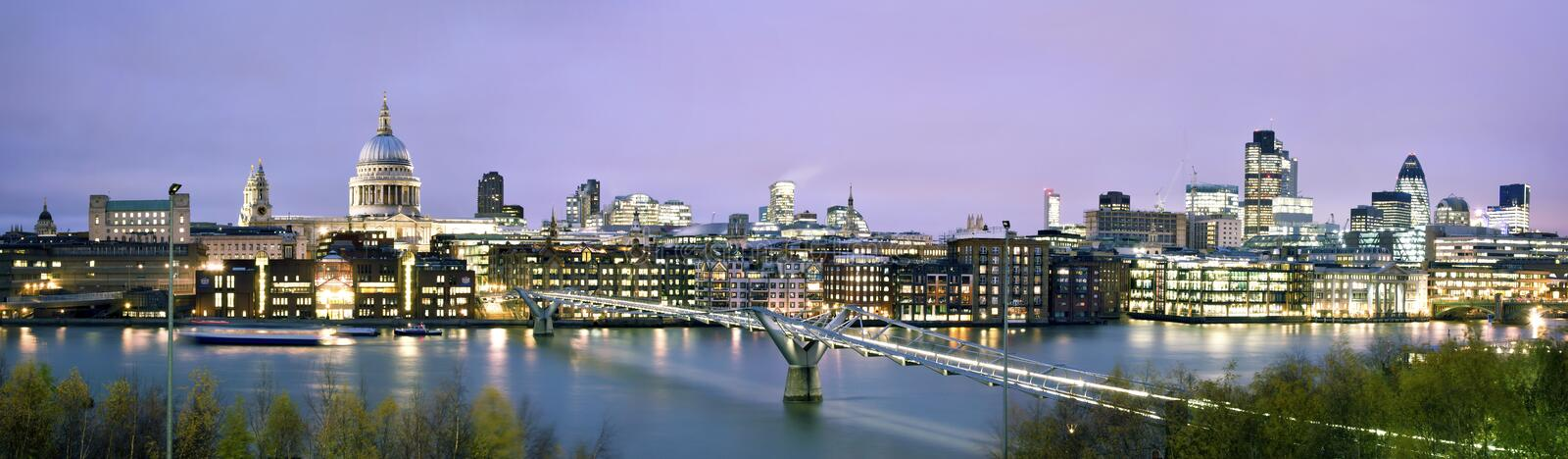City of London at twilight. Panoramic picture of St. Paul's Cathedral, Millenium Bridge and the Financial District at twilight stock photo