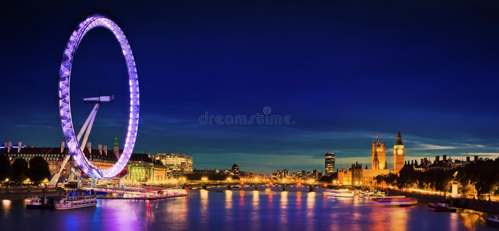 City of London at twilight. London at twilight. London eye, County Hall, Westminster Bridge, Big Ben and Houses of Parliament stock photography