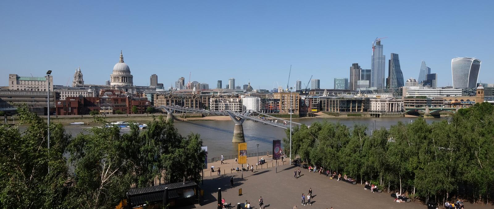 City of London, United Kingdom 6th July 2019: London skyline panorama seen from south bank. St Pauls Cathedral and river Thames in foreground on summer day royalty free stock photo